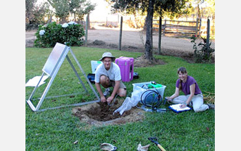 Researchers George Slad and Anne Meltzer install a seismic station near a farmhouse in Chile.