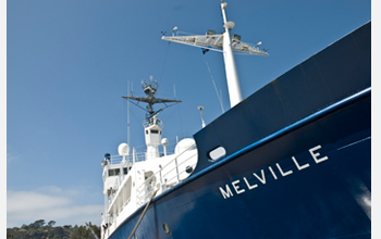 Photo of the Melville underway on an oceanographic expedition.