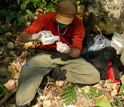 Photo of graduate student Brian Szekely conducting a fecal analysis on chimpanzee stool samples.