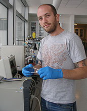 Doctoral student John Chmiola assembling an electrochemical capacitor test cell.