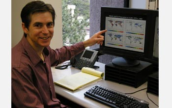 Photo of Peter Lawrence pointing to landcover changes on a computer screen.