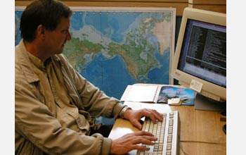 Photo of University of Colorado Engineering Professor Tom Chase working at his computer.