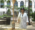 Photo of Cherlyn Anderson demonstrating the notorious Diet Coke and Mentos experiment at NSF.