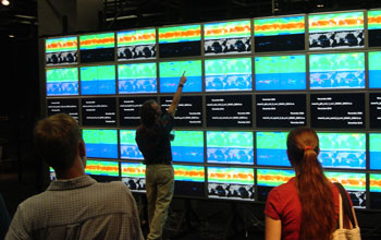 Photo of someone using the HiPerWall display at the University of California, San Diego.
