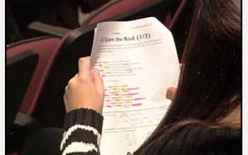 Photo of a student working through the North American Computational Linguistics Olympiad challenge.
