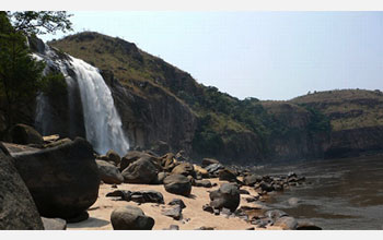 Photo of waterfall cascading down the steep cliffs of the lower Congo River.