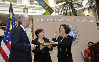 NSF Director France Cordova takes the oath at NSF headquarters with her cousin and John Holdren