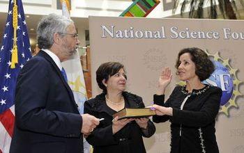 France Cordova being sworn in with John Holdren and Adrienne Cordova
