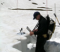 Photo of Tom Painter tracking radiation in June 2007.