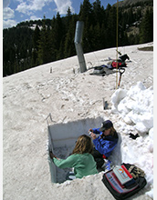 Photo of Annie Bruyant and McKenzie Skiles collecting snow samples in Wolf Creek Pass, Colo.