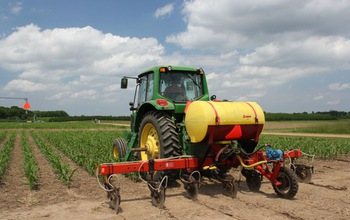 tractor  in a corn field at the NSF Kellogg Biological Station LTER site.