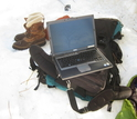 laptop, backpack and snowshoes used in the field while doing research