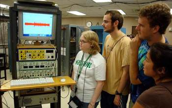group of students with scientific equipment
