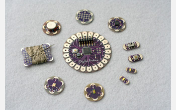 Photo of a circular array of sewable electronic components forming an interactive embroidery.