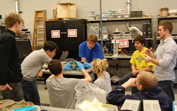 The scientific team assemblying the RAX cubesat.