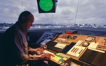 Man using traffic control instruments