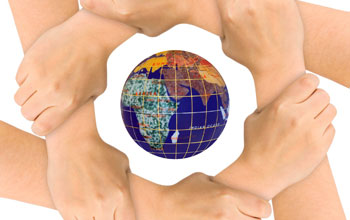 Image of six hands locked together in a circle with the earth in the middle.