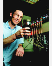 Photo of Daniel Bond holding Geobacter microbes.