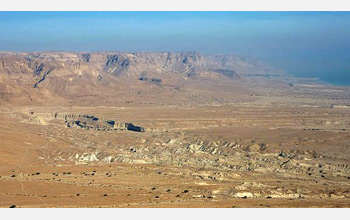 Photo of the arid mountain ranges flanking the Dead Sea. They reach 1,000 meters above water level.