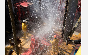 Seawater sprays on the JOIDES Resolution rig floor during drilling operations.