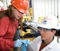 Microbiologist Maria-Cristina Ciobanu and geochemist Simon George sample a core.