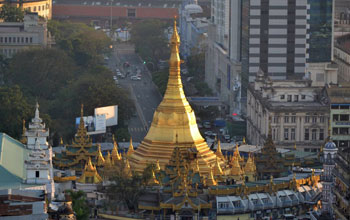 Pagoda in Myanmar surrounded by buildings