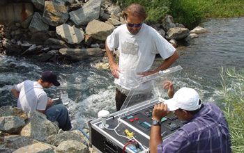 Photo of P.V. Sundareshwar with co-authors Berdanier and Honomichl analyzing water quality.