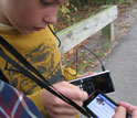 A students with smartphone and water measurement probes