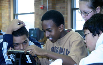 Photo of high school students using a digital game-based learning program.