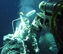 Image of a robotic device measuring chemosynthetic processes at a hydrothermal vent in deep ocean.