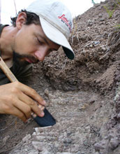 Paleontologist Christian Sidor excavates a fossil in Tanzania.