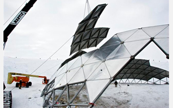 Photo of a crane removing a section of the geodesic dome at Amundsen-Scott South Pole Station.