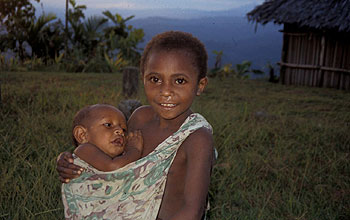 Older child carrying an infant