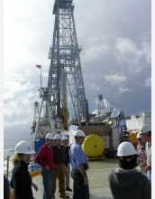 Scientists drill into ocean crust from aboard the vessel JOIDES Resolution.