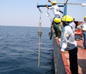 Photo of researchers conducting sediment coring to retrieve samples from Lake Tanganyika's floor.