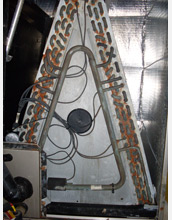 Photo showing corrosion and damage to copper components in an air handling system.