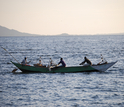 Fishers returning at dawn. Using lamps, they fish for dagaa, a kind of sardine, at night.