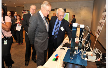 Photo of Sen. Reid with shake table that simulates earthquake motions.