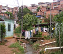 Photo of houses and a clothes line in an urban area in Brazil.
