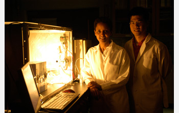 Sossina Haile (left) and William Chueh (right) stand next to thermochemical reactor for H2O and CO2.