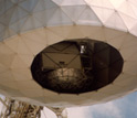 Photo showing the inside the dome of the Arecibo Observatory, where there is a pulsar detector.