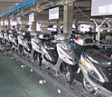 Photo shows e-bikes on a Chinese assembly line.