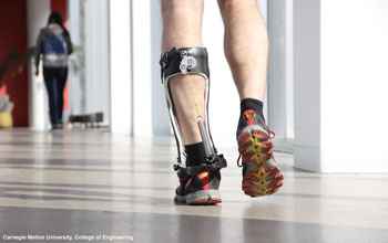 photo showing a man's legs with a robotic prosthesis