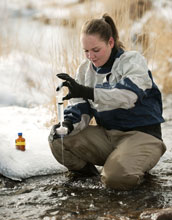 Photo of University of Wyoming student Sarah Ann Gregory gathering water samples for research.