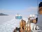The USCGC Polar Star escorts a tanker through the sea ice of McMurdo Sound.