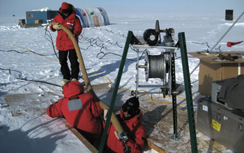 Image of researchers sampling ice at the South Pole.