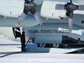Photo of a ski-equipped Hercules LC-130 refueling in Antarctica.