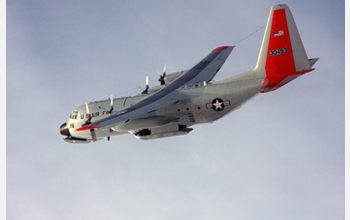 Photo of a LC-130 Hercules flying over NSF's Amundsen-Scott South Pole Station.