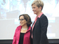 NSF Director France C�rdova and Heidi Capozzi, Boeing senior vice president of human resources, stand together on a stage.