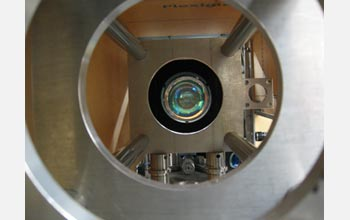 Photo of end-on view of high numerical aperture custom lens system used to trap and image an atom.